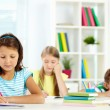 Girl drawing at workplace — Stock Photo