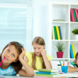 Girl drawing at workplace with schoolmates — Stock Photo #49214541