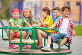 Kids on carousel — Stock Photo