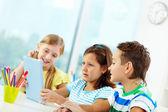 Classmates using digital tablet — Stock Photo