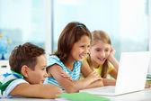 Classmates using laptop — Stock Photo
