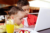 Children typing on laptop — Stock Photo