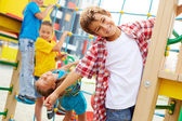 Kids having fun on playground — Stock Photo