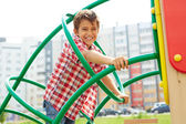 Kid having fun on playground — Stock Photo