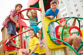 Friends having fun on playground — Stock Photo