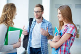 Friends talking during break in college — Stock Photo