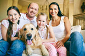 Friendly family and dog — Stock Photo