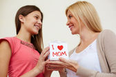 Teenage girl congratulating her mom — Stock Photo