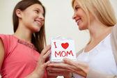 Teenage girl congratulating her mom — Stock Photo