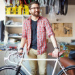 Handsome man with bicycle — Stock Photo #49262157