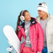 Girl and man in winterwear holding snowboard — Stock Photo #49264427
