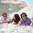 Friends resting on the sand — Stock Photo #49267403