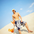 Young man sandboarding — Stock Photo #49267477