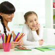 Girl and mother drawing with colorful pencils — Stock Photo