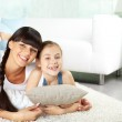 Girl and her mother resting at home — Stock Photo #49269911