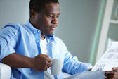 African man reading news — Stock Photo