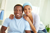 African couple with smiles — Stock Photo