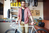 Handsome man with bicycle — Stock Photo