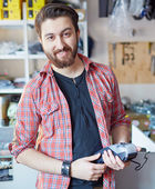 Handsome man at the cash register — Stock Photo
