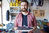 Man selling footwear — Stock Photo