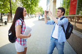 Man taking photo of girlfriend during journey — Stock Photo