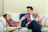 Couple having rest on sofa — Stock Photo
