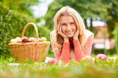 Girl with ripe apples — Stock Photo