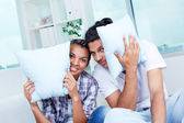 Guy and girl with pillows — Stock Photo