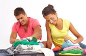 Couple preparing clothes for journey — Stock Photo