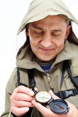 Man looking at compass — Stock Photo