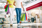Shoppers with paperbags — Stock Photo