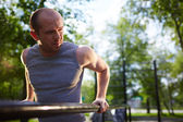 Man training on sport equipment — Stock Photo