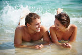 Couple lying in water — Stock Photo