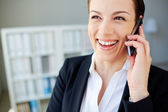 Pretty employee speaking on cellphone — Stock Photo