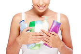 Woman holding bottles — Stock Photo