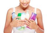 Woman holding bottles — Foto de Stock