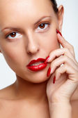 Woman with red lips and fingernails — Stock Photo