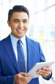 Businessman with touchpad — Stock Photo