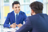 Businessman with colleague at meeting — Stock Photo
