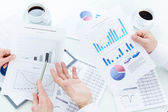 Business partners during analysis of marketing — Stock Photo