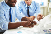 Businessmen discussing computer project — Stock Photo