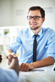Businessman handshaking with partner — Stock Photo