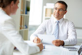 Businessman speaking to his colleague — Stock Photo