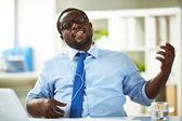 Businessman taking pleasure in music — Stock Photo