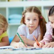 Girls and cute boy drawing — Stock Photo #51566987