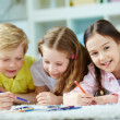 Girls and cute boy drawing — Stock Photo #51567003