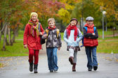 Schoolkids going to school — Stock Photo