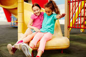 Girls spending time on playground — Stock Photo