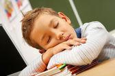 Boy sleeping in classroom — Stock Photo