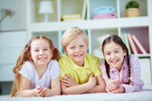 Three little friends with smiles — Stock Photo